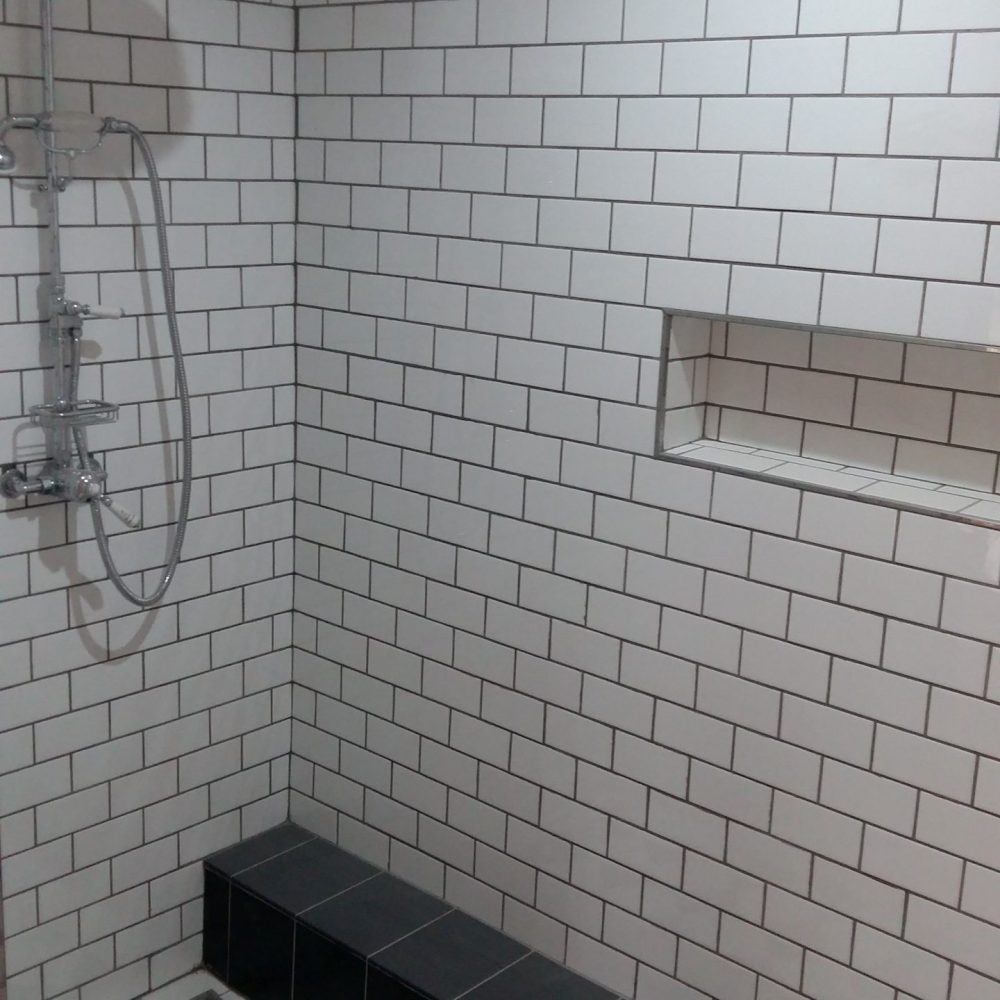 Shower walls and floor tiling done